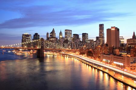 manhattan and brooklyn bridge at night