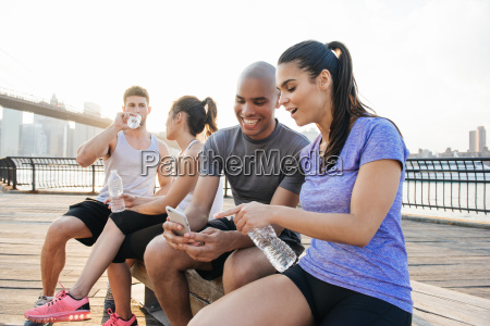 four young adult running friends on