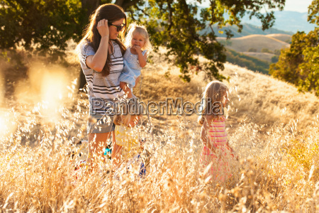 mother and daughters taking walk mt