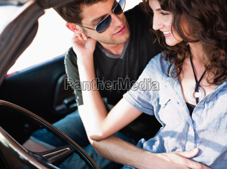 couple embracing in car