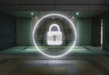glowing padlock symbol in office building