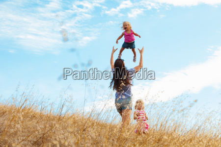 mother and daughters having fun mt