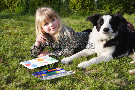 child paint with her dog in