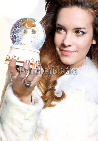cheerful festive woman in white fur