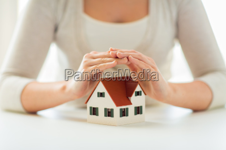close up of hands protecting house