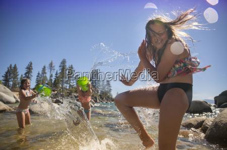 girls enjoying in the water at