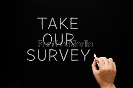 take our survey handwritten on chalkboard