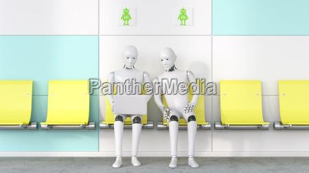 dwa roboty patrzac na laptopa renderowanie