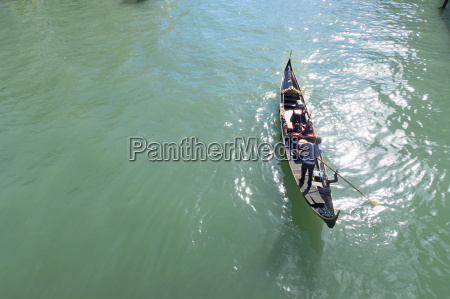 high angle view of gondolier paddling