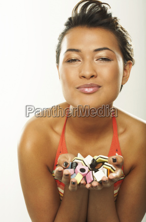 portrait of woman with handful of