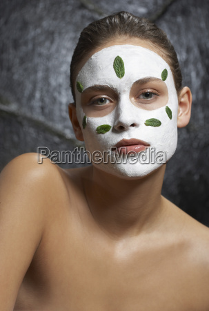portrait of woman with facial mask