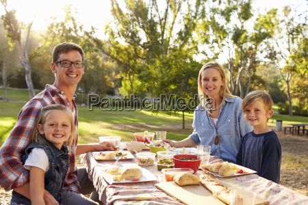 young family at a picnic in