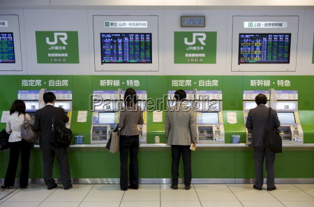 passengers purchasing bullet train tickets from