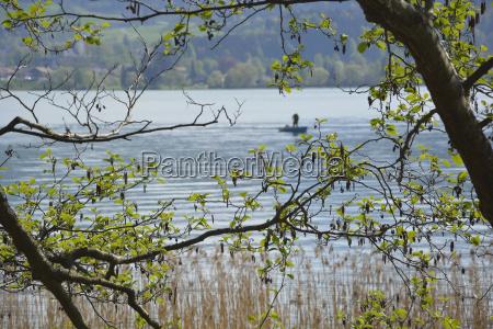 fisherman at lake tegernsee bavaria germany