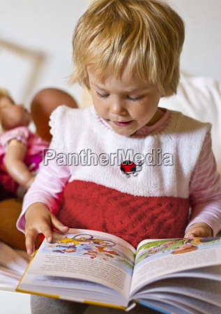 girl looking at book close up