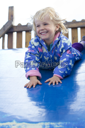 germany girl playing on blue slide