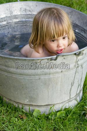germany baden wuerttemberg girl taking bath