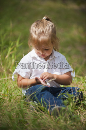 usa texas girl sitting on grass