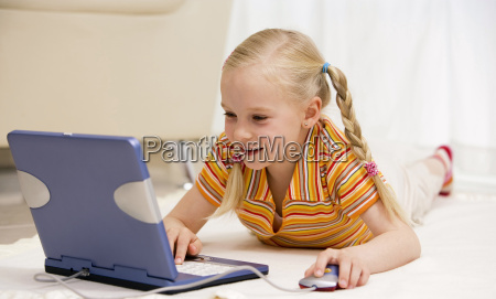 young girl 10 11 using laptop