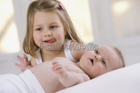 little girl 3 4 and baby