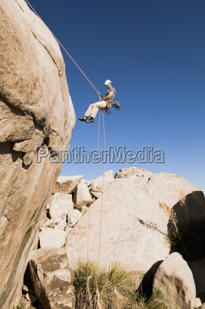 man, rappelling, from, cliff - 21393861