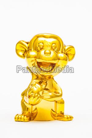 zwolniony zwierze statula malpa zabawka zloty