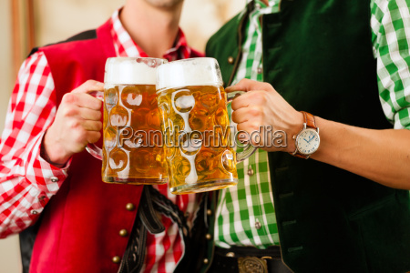 two young men in traditional bavarian