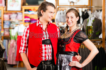 couple, is, trying, dirndl, or, lederhosen - 21475781