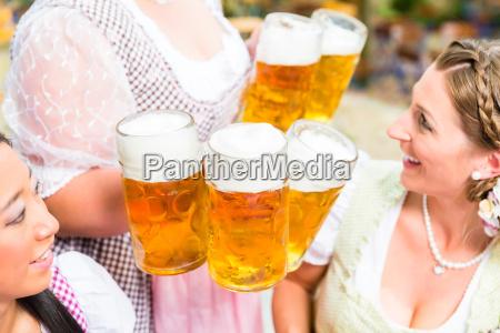 waitress serving beer in five beer