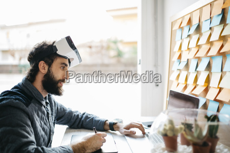 man with virtual reality glasses working