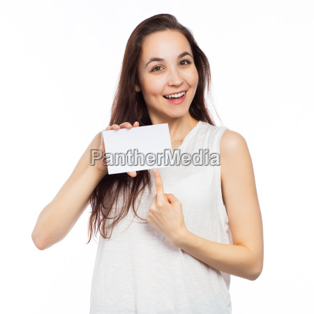 cheerful woman pointing at a blank