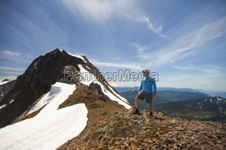 hiker standing on mountain in cheam