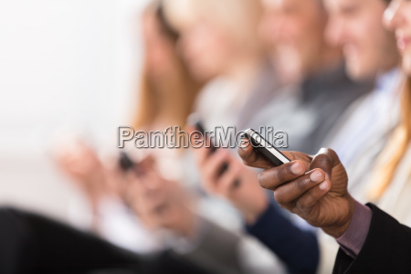 businesspeople using smart phone