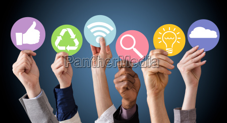 businesspeople hands holding various business symbols