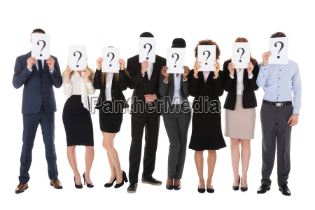 businesspeople hiding behind question mark sign