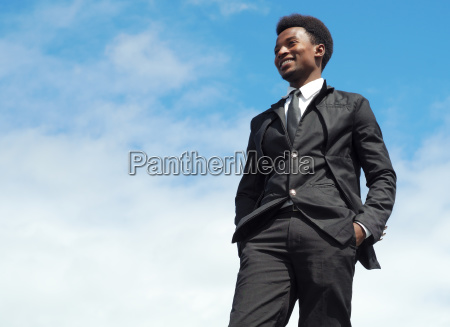 young businessman leader low angle view