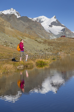 a female hiker is standing at