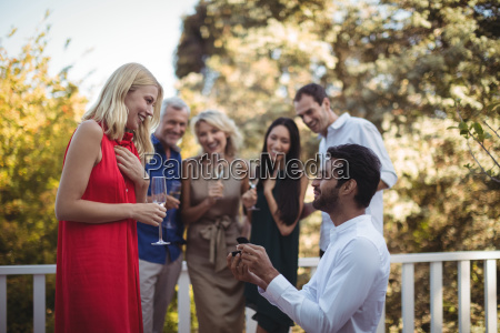 man proposing woman in balcony