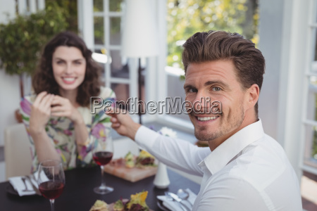 handsome man offering engagement ring to
