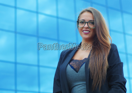 young businesswoman blue building background successful