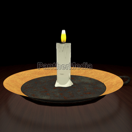 candle lit in the darkness