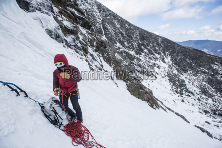 front view of climber preparing ropes