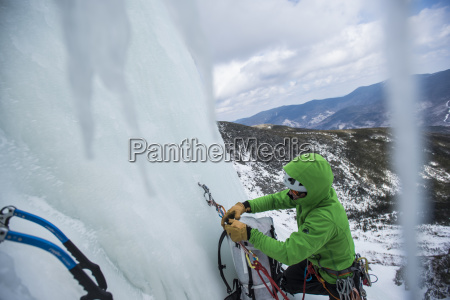 climber checking ropes before ice climbing