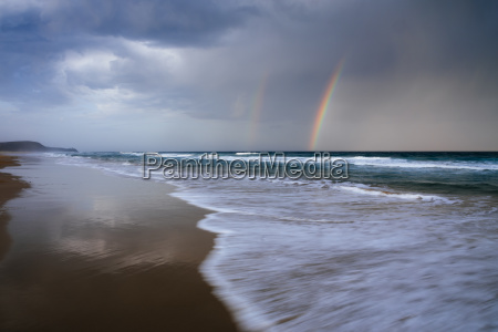 beach and ocean landscape with rainbow