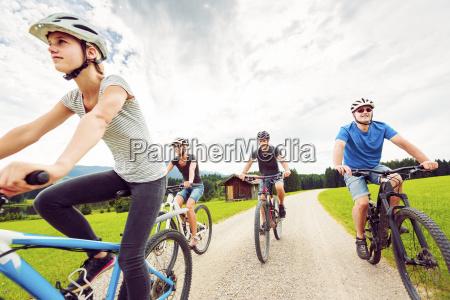 germany bavaria pfronten family riding mountain