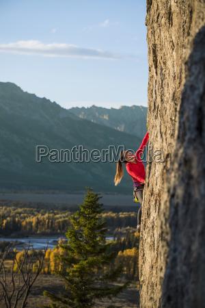 female climber climbing in teton range