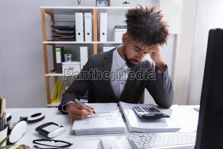 unhappy businessman working in office