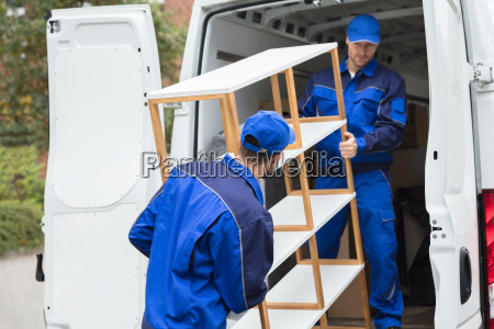 two, delivery, men, unloading, shelf, from - 23599800