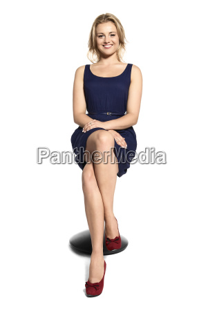 smiling young woman sitting on a