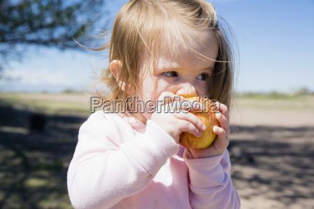 portrait of girl 2 3 eating
